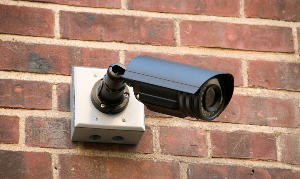 wireless outdoor camera mounted on a wall